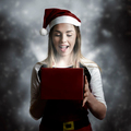 Christmas present girl opening magic gift box