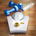 Fitness and weight loss concept. Weigh scales, dumbells and meas