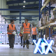 Manual Workers Walking Over Warehouse