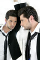Handsome narcissistic young man looking in a mirror - PhotoDune Item for Sale