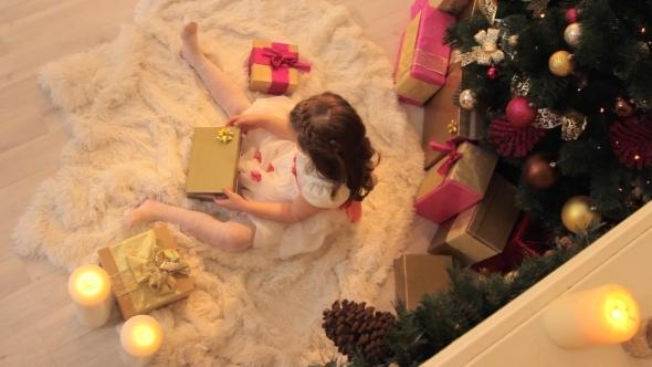 Girl Opening Christmas Gift