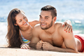 Happy young lovers sunbathing