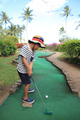 Japanese boy playing with putting golf (5 years old)