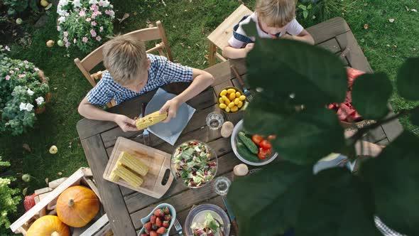 VideoHive Vegan Family Eating Fruit and Vegetables in Garden 19675473