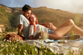 Loving young couple relaxing on summer picnic