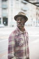 Half length portrait of young handsome afro black man overlookin
