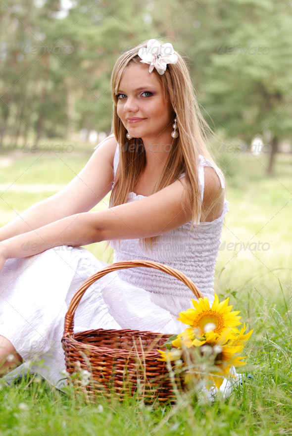 Beautiful young woman in white dress - Stock Photo - Images