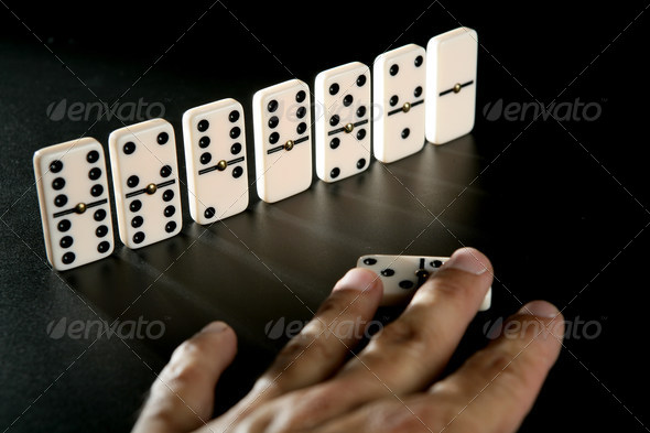 Domino game business metaphor - Stock Photo - Images