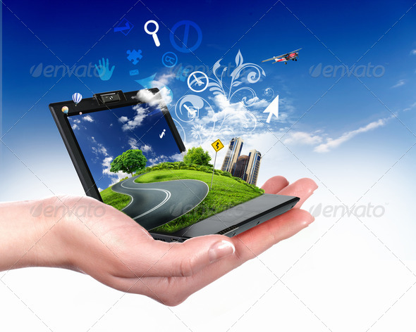 Human hand holding a green landscape - Stock Photo - Images