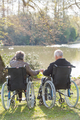 elderly couple looking at a lake