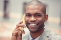 headshot handsome happy laughing young business man talking on mobile phone