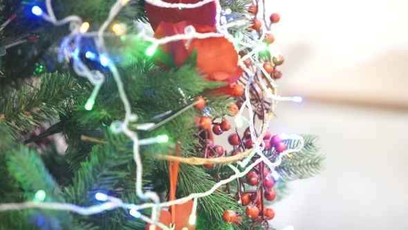 Christmas Tree Decorated With Garlands And Toys