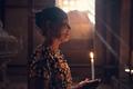 Burmese woman praying with candle light