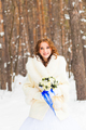Bride and bridal bouquet in the winter.