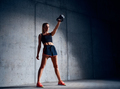 Young woman doing kettlebell swing exercise