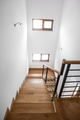 Living room stairs, modern minimalist interior design. Wooden staircase with metallic elements