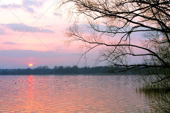 Red sunset over lake - Stock Photo - Images