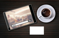 On line shopping on tablet screen with coffee cup and white busi
