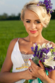 Beautiful bride blond blue eyes green field