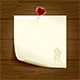 Paper with Heart on Wooden Background