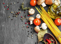 Italian meal ingredients with pasta,spices,tomatoes,olive oil an