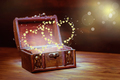 beautiful background of vintage chest with light heart miracle o