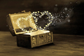 beautiful concept of vintage chest with light heart miracle on w