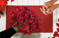 Man gives a woman a bouquet of roses for Valentines Day