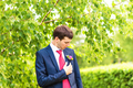 groom in the wedding suit with boutonniere