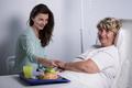 Elderly patient with her caregiver