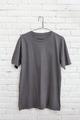 grey t-shirt hanging on the wall