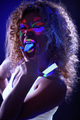 Amusing visage model posing in UV light