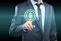Businessman presses digital interface dollar sign