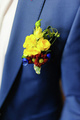 Pinning a Boutonniere for groom on his wedding