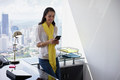 Business Woman Text Messaging On Phone In Office 3