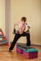 Man doing exercises with dumbbells.