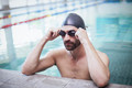 Focused man wearing swim cap and goggles at the pool