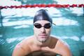 Man wearing swimming goggles in the swimming pool