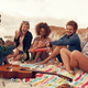 Download Friends enjoying at beach party from PhotoDune