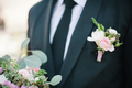 Pinning a Boutonniere for groom