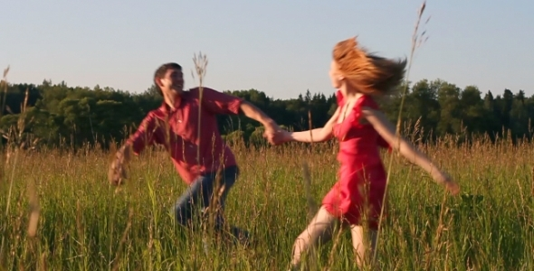 Couple Running in the Field