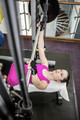 Fit woman lifting the barbell bench press in gym