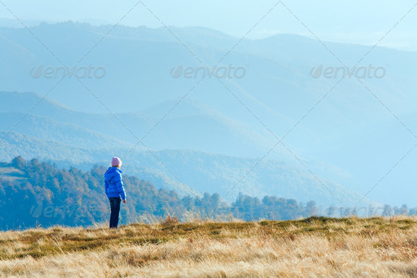 Small girl on autumn  mountain plateau - Stock Photo - Images
