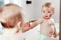 Mirror kiss baby
