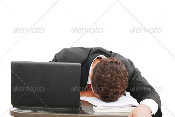 A portrait of a tired businessman resting his head on books over - Stock Photo - Images