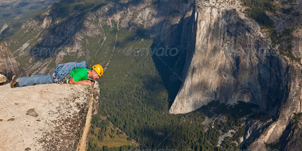 Rock climber on the summit. - Stock Photo - Images