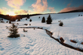 sunset over mountain river in winter