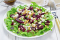Salad with beets, feta cheese and walnuts, dressed with balsamic sauce