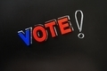 Vote with a big exclamation mark on a blackboard - PhotoDune Item for Sale