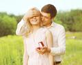 Boyfriend closed his eyes a girl, making a surprise ring, romanc